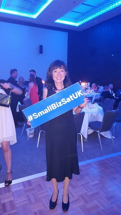 Owner of soft baby towels retailer Bathing Bunnies, Angela Taylor, holding her small business award